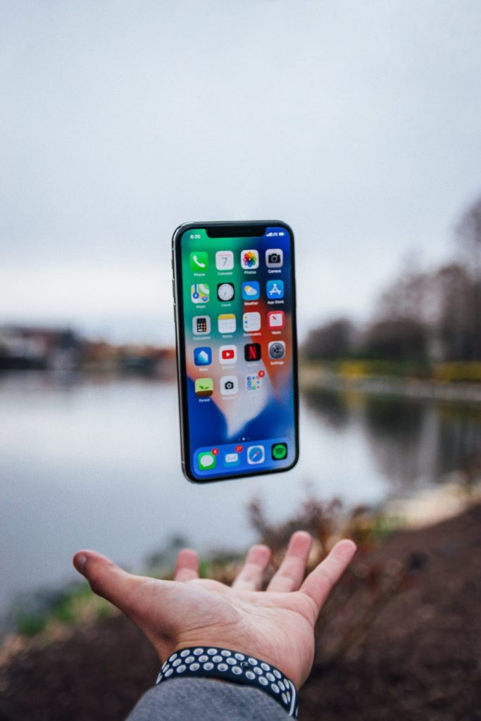 A phone and a wide-opened hand